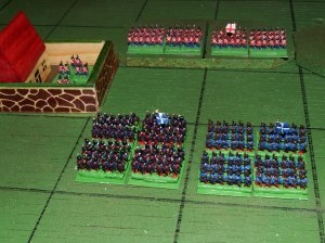 Two companies of skirmishers hold la Haie Sainte as Blue columns advance towards the Red line on the ridge