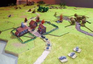 From the southeast looking along the German axis of attack.  The road is littered with burning vehicles.