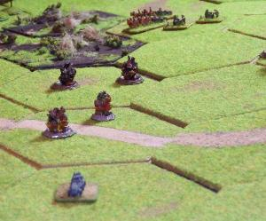 Back in the centre the German armoured car runs from a creeping artillery barrage.
