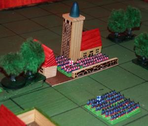 A Blue column prepares to assault a village held by Red.